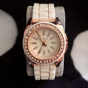 Rose gold watch with white silicone band